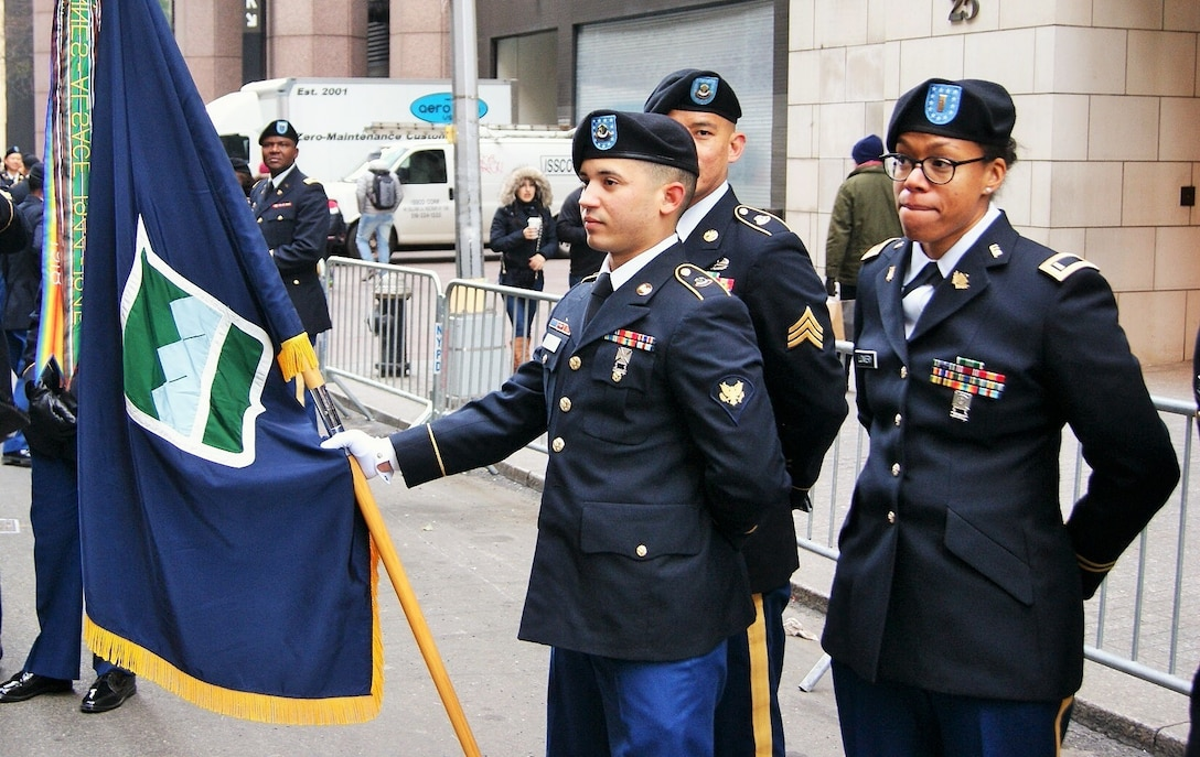 Soldiers of the 3rd Brigade Civil Affairs/Military Information Special Operations, 102nd Training Division, 80th Training Command, prepare to carry the 80th's colors at the New York City Veterans Day parade Nov. 11, 2017.