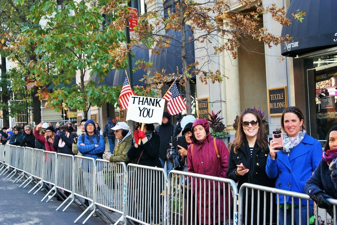 """Thousands of spectators line the streets, waving flags and """"thank you"""" signs, to show their appreciation for the nation's military veterans at the New York City Veterans Day Parade Nov. 11, 2017."""