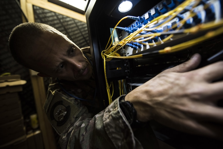 SMSgt Brandon McCoy, 332nd Expeditionary Communications Squadron Superintendent, checks the installation of new wireless internet firewall equipment Nov. 13, 2017, in Southwest Asia. The firewall improvements will ensure a safe, reliable connection to the web for deployed service members. (U.S. Air Force by Senior Airman Joshua Kleinholz)