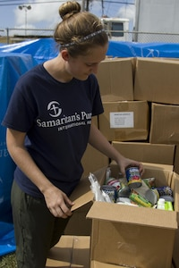 Volunteer Checks Grocery Box