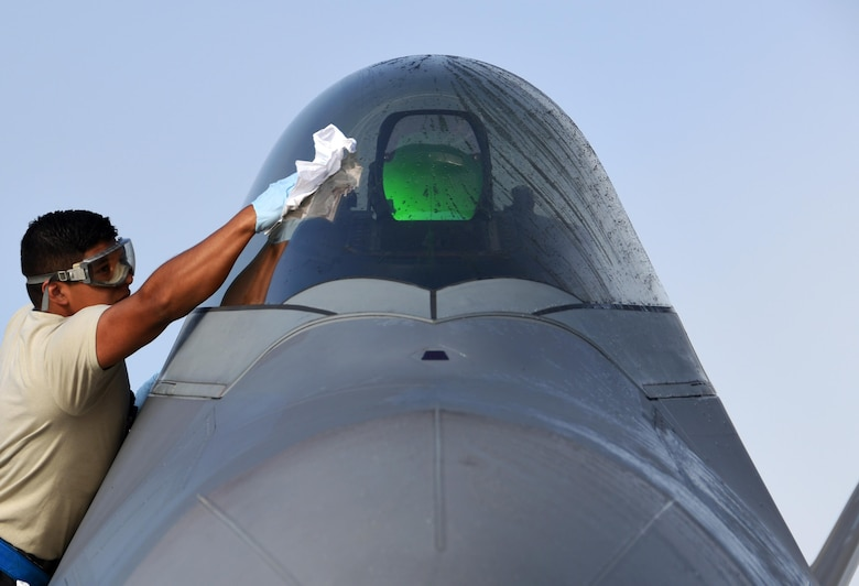 U.S. Air Force Airman 1st Class Andrew Alcozer, 3rd Aircraft Maintenance Squadron crew chief, cleans the canopy of a 525th Fighter Squadron F-22 Raptor at Tyndall Air Force Base, Fla., Nov. 7, 2017. Tyndall AFB is the host location for Checkered Flag 18-1, a large-scale aerial exercise designed to integrate fourth and fifth-generation airframes while providing a platform for maintenance teams to be evaluated. (U.S. Air Force photo by Airman 1st Class Isaiah J. Soliz/Released)