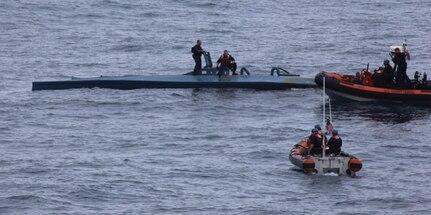 A U.S. Coast Guard boat crew interdicts a self-propelled semi submersible vessel.