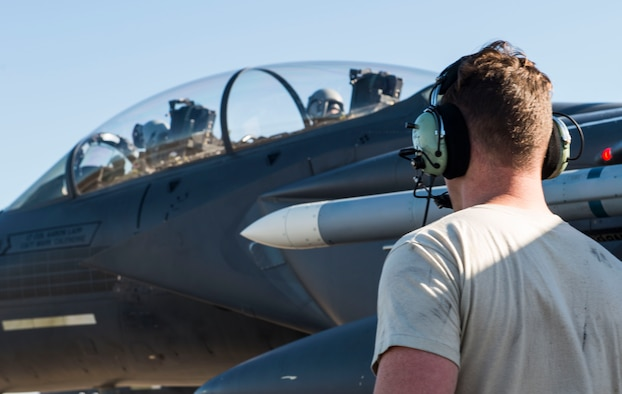 Staff Sgt. Jamie Morgan, 389th Aircraft Maintenance Unit crew chief, speaks to the crew preparing for takeoff during Checkered Flag 18-1 at Tyndall Air Force Base, Fla. Nov. 6, 2017. Checkered Flag gave fourth generation and fifth generation aircraft the opportunity to integrate together. (U.S. Air Force photo by Senior Airman Malissa Armstrong)