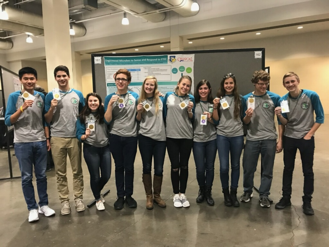 The Air Force Research Laboratory-Carroll High School iGEM team proudly displays their gold medals after the international iGEM competition in Boston Nov. 13.