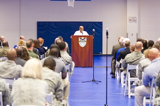 Dr. Harold Brown speaks with military men and women at U.S. Southern Command headquarters.