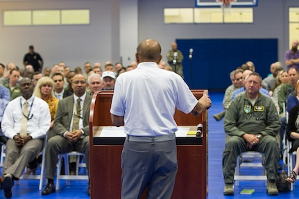 Dr. Harold Brown speaks with military men and women at U.S. Southern Command headquarters