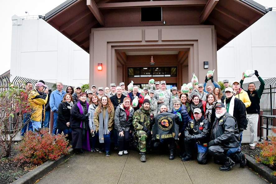 WADS members and community partners pose for a photo during the 8th annual Operation Turkey Drop, Nov. 16, 2017.  Operation Turkey Drop helps ease financial burdens of holiday expenses for Airmen and Soldiers on Joint Base Lewis-McChord and Camp Murray. The event is made possible by the Association of the United States Army, the Air Force Association and Pierce Military and Business Alliance and dozens of local businesses and organizations. (U.S. Air National Guard photo by Capt. Kimberly D. Burke)