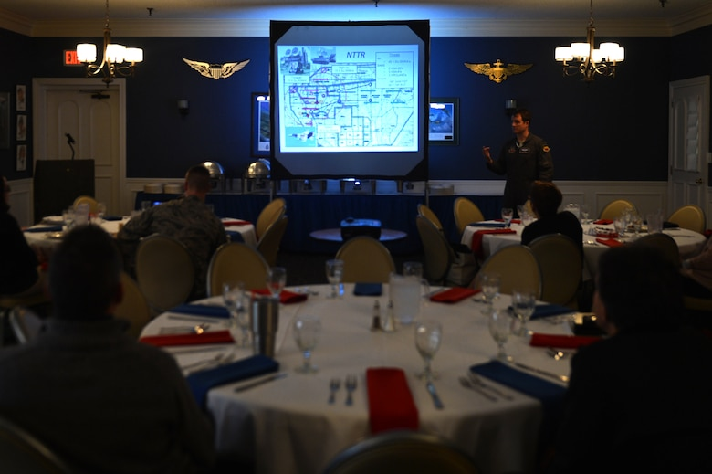 "Team Shaw members attend a 55th Fighter Squadron ""flags"" exercise brief at the 20th Force Support Squadron Carolina Skies Club and Conference Center at Shaw Air Force Base, South Carolina, Nov. 15, 2017."