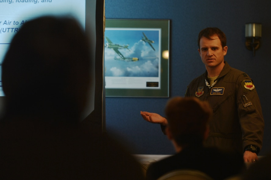 "U.S. Air Force Capt. Taylor Roach, 55th Fighter Squadron (FS) flight commander, speaks to members of Team Shaw during a 55th FS ""flags"" exercise brief at the 20th Force Support Squadron Carolina Skies Club and Conference Center at Shaw Air Force Base, South Carolina, Nov. 15, 2017."