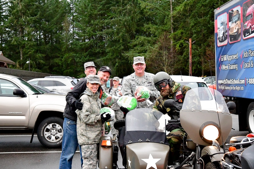 Members of the Combat Veterans Motorcycle Association deliver turkeys to Western Air Defense leadership as part of the 8th annual Operation Turkey Drop Nov. 16, 2017.  Operation Turkey Drop helps ease financial burdens of holiday expenses for Airmen and Soldiers on Joint Base Lewis-McChord and Camp Murray.  The event is made possible by the Association of the United States Army, the Air Force Association and Pierce Military and Business Alliance and dozens of local businesses and organizations.  (U.S. Air National Guard photo by Capt. Kimberly D. Burke)