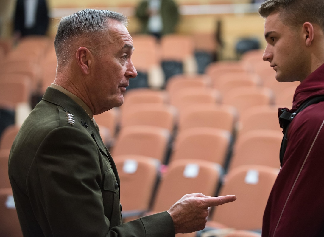 Marine Corps Gen. Joe Dunford speaks with a college student