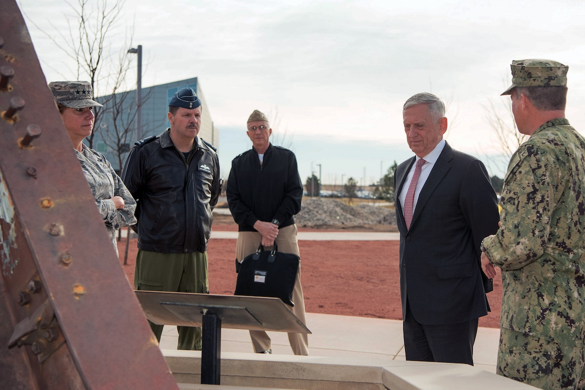 Defense Secretary Jim Mattis talks to members of the military.