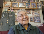 Kwethluk, Alaska - Retired Sgt. 1st Class Sam Jackson, who served in the Alaska Territorial Guard during World War II, poses for a photo inside his home in Kwethluk, Alaska, Sept. 23, 2017.