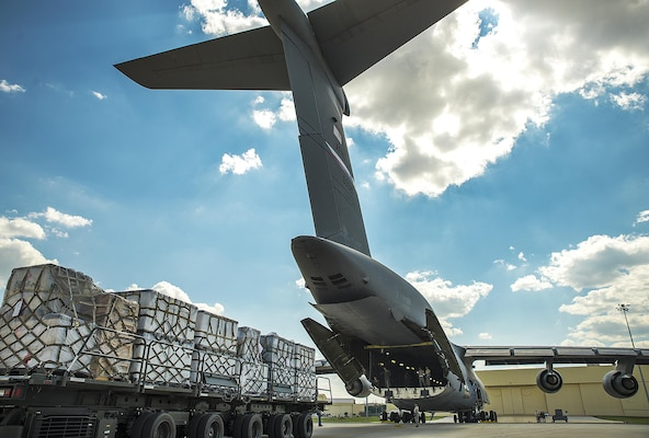 A Halvorsen Loader backs up to the ramp of a C-5M Super Galaxy aircraft at the 433rd Airlift Wing in support of Hurricane Harvey relief efforts August, 30, 2017 at Joint Base San Antonio-Lackland, Texas.