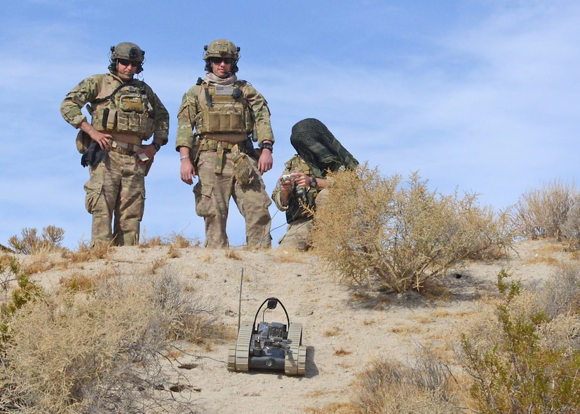 Explosive Ordnance Disposal Airmen deploy an all-terrain robot to inspect a possible booby trap during a two-week long training event and bivouac conducted by the 812th Civil Engineer Explosive Ordnance Flight at Edwards AFB earlier this month. (U.S. Air Force photo by Kenji Thuloweit)