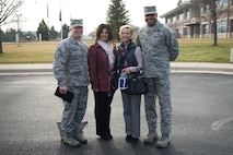 Chief Master Sgt. Brendan I. Criswell, Command Chief Master Sergeant, Air Force Space Command, his wife, Christine, Chief Master Sgt. Rod Lindsey, 460th Space Wing command chief, and his wife, Stacy, pose for a photo in front of the 460th Space Wing Headquarters Nov. 9, 2017, on Buckley Air Force Base, Colo.