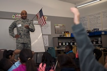 Chief Master Sgt. Rod Lindsey, 460th Space Wing command chief, speaks to students at Edna and John W. Mosley P-8 School Nov. 9, 2017, in Aurora, Colo.
