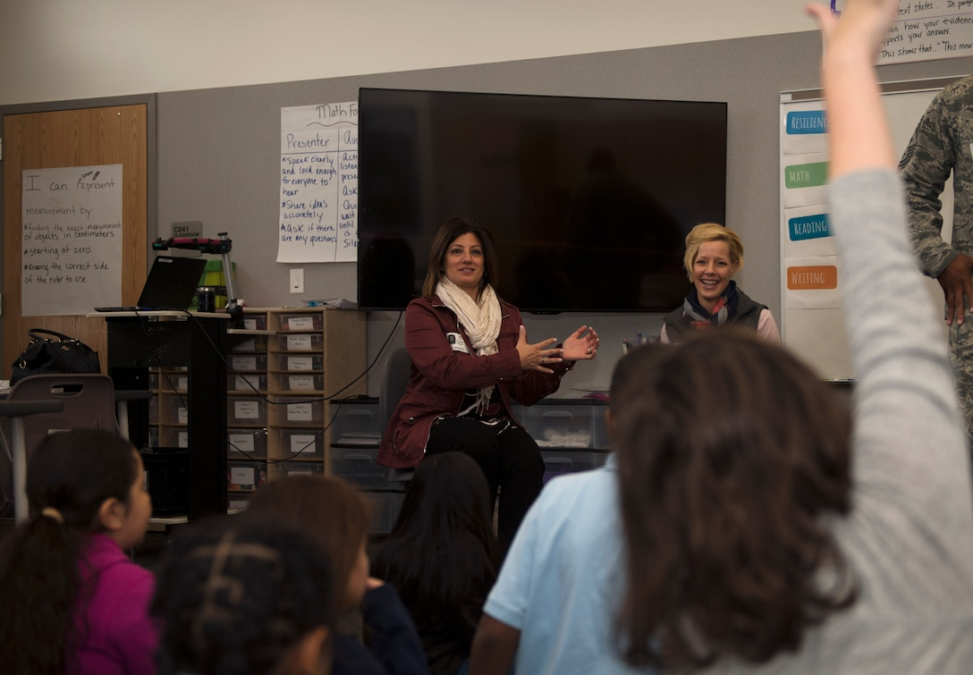Christine Criswell, wife of Chief Master Sgt. Brendan I. Criswell, Command Chief Master Sergeant, Air Force Space Command, and Stacy Lindsey, wife of Chief Master Sgt. Rod Lindsey, 460th Space Wing command chief, speak to students at Edna and John W. Mosley P-8 School Nov. 9, 2017, in Aurora, Colo.