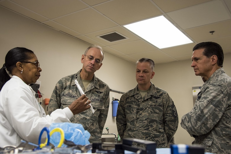 Sandra Pittman, 23d Medical Group (MDG) dental assistant, briefs Lt. Gen. Mark Ediger, Surgeon General of the Air Force (AF/SG), Brig. Gen. Sean Murphy, Air Combat Command Surgeon General (ACC/SG), and Chief Master Sgt. George Cum, Air Force Chief of Medical Enlisted Force Nov. 15, 2017, at Moody Air Force Base, Ga. The AF/SG and ACC/SG visited Moody to get a better understanding of the 23d MDG's mission. (U.S. Air Force photo by Airman Eugene Oliver)