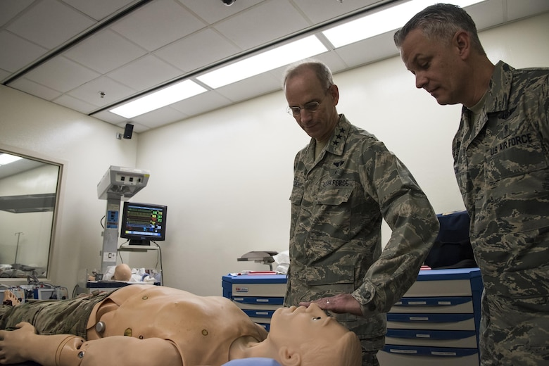 Lt. Gen. Mark Ediger, Surgeon General of the Air Force (AF/SG), left, and Chief Master Sgt. George Cum, Air Force Chief of Medical Enlisted Force, examine a mannequin, Nov. 15, 2017, at Moody Air Force Base, Ga. The AF/SG visited Moody to get a better understanding of the 23d MDG's mission. (U.S. Air Force photo by Airman Eugene Oliver)