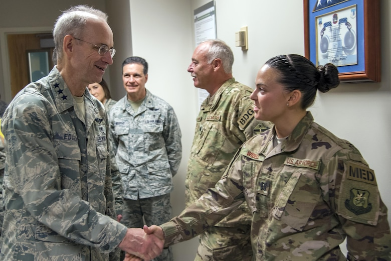 Lt. Gen. Mark Ediger, Surgeon General of the Air Force (AF/SG) shakes hands with Capt. Heather Widdell, 823d Base Defense Squadron medical assistant, Nov.15, 2017, at Moody Air Force Base, Ga. The AF/SG visited Moody to get a better understanding of the 23d Medical Group's mission. (U.S. Air Force photo by Airman Eugene Oliver)