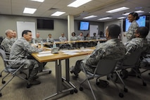 Lt. Col. Stephenie Williams, 23d Medical Support Squadron commander, briefs Brig. Gen. Sean Murphy, Air Combat Command Surgeon General (ACC/SG) and Lt. Gen. Mark Ediger, Surgeon General of the Air Force (AF/SG) Nov.14, 2017, at Moody Air Force Base, Ga. The AF/SG and ACC/SG visited Moody to get a better understanding of the 23d Medical Group's mission. (U.S. Air Force photo by Airman Eugene Oliver)