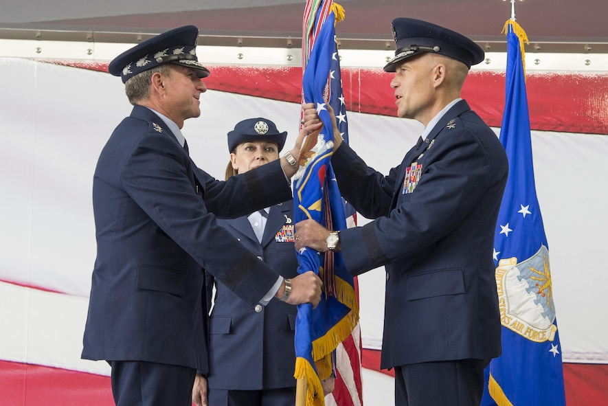 U.S. Air Force Chief of Staff Gen. David L. Goldfein, hands the guidon to Lt. Gen. Steven Kwast officially signifying his assumption of command of Air Education and Training Command Nov. 16, 2017, at Joint Base San Antonio-Randolph, Texas. Kwast, a U.S. Air Force Academy graduate, assumed command after spending the previous three years as president and commander of Air University, Maxwell Air Force Base, Alabama (U.S. Air Force photo by Sean Worrell)