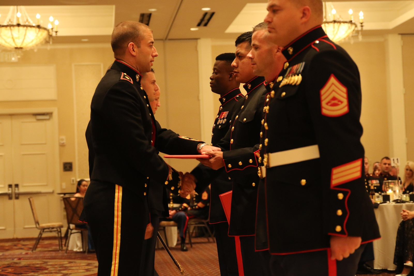 Sgt. Domingo Hernandez receives the award for Recruiter of the Year for Recruiting Station Oklahoma City before the beginning of the Marine Corps Ball.   Hernandez has been moved from being a recruiter on production to being a Staff NCOIC for Recruiting Substation Midwest City.