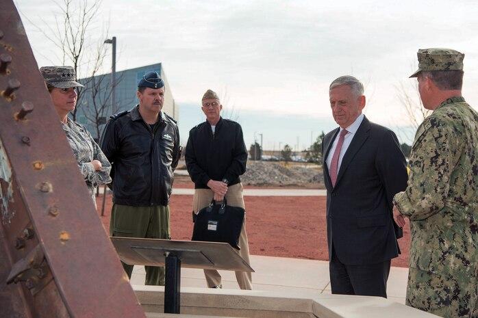 Defense Secretary Jim Mattis talks to members of the military.