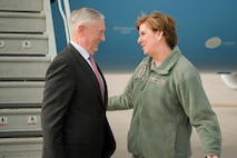 Defense Secretary Jim Mattis talks with Northcom's commander at the steps of an aircraft.