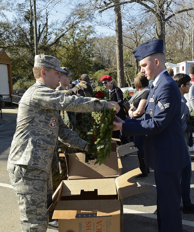 The program promotes laying wreaths on veterans' graves to remember and honor military members who have passed away.