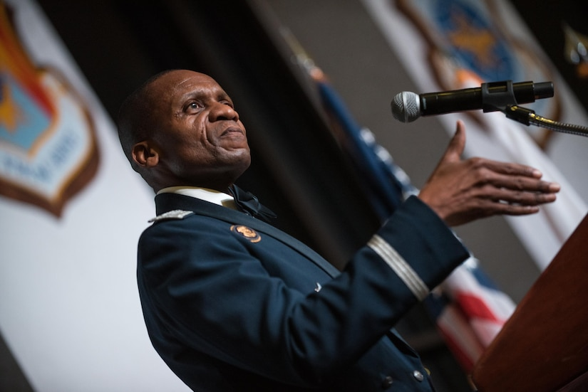 Air Force Gen. Darren W. McDew speaks at a podium