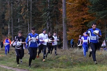 Allied Air Command inter-nation orienteering competitors run through a course at Brandon Country Park, England, Nov. 15. Members of multiple NATO nations participated in the event, which featured teams from the Belgium Air Force, Polish Air Force, Royal Netherlands Air Force, German Air Force, Royal Air Force, and the U.S. Air Forces in Europe.