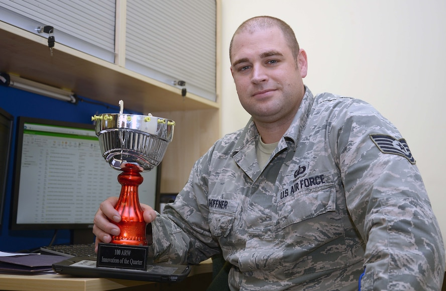 U.S. Air Force Tech. Sgt. Bruce Shoffner, 100th Comptroller Squadron quality assurance manager, sits with the Innovation of the Quarter trophy at RAF Mildenhall, England, Nov. 16, 2017. The trophy is comprised of different elements from each past innovation winner and will continue to be augmented by future winners. (U.S. Air Force photo by Airman 1st Class Benjamin Cooper)