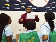 U.S. Army Corps of Engineers, Mobile District Water Management Chief James Hathorn introduces students to the fun side of math and science using a problem-solving game during a visit to a local elementary school earlier this year. Hathorn volunteers in the community regularly as a way to give back for the positive mentorship he received as a child.