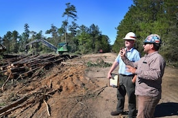Quinn Kelly, left, and contractor Kasey Knight, discuss timber clearing operations at Stennis Space Center last week.