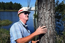 Quinn Kelly, Mobile District forestry technician, inspects a pine tree at Stennis Space Center in Mississippi last week. Kelly protects an acoustic buffer of approximately 142,000 acres around Stennis from wildfires through firebreaks, controlled burns and thinning the timber areas.
