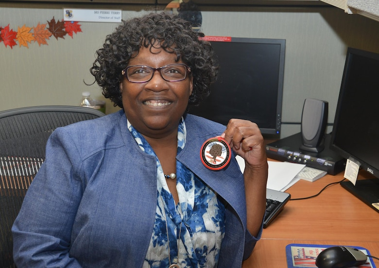 Pierre Terry, director of staff, 25th Air Force's Logistics, Engineering and Force Protection Directorate (A4), is the civilian recipient of the 2018 Brig. Gen. Wilma Vaught Visionary Leadership Award for Air Combat Command. Terry holds the 25th Air Force INSPIRE program emblem she designed.