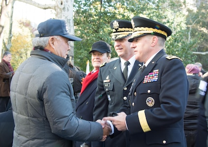 (Center) Brig. Gen. Robert S. Cooley, commander of the 353d Civil Affairs Command, and (Right) Maj. Gen. Mark W. Palzer, commander of the 79th Theater Sustainment Command, talk with a veteran (Left) at the opening wreath laying ceremony of the NYC Veterans Day Parade, November 11, 2017. (U.S. Army Reserve Photo by Maj. Addie Leonhardt, 80th Training Command)