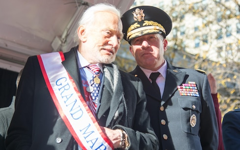 (Left) Buzz Aldrin, Grand Marshall of this year's NYC Veterans Day Parade, and (Right) Maj. Gen. Mark W. Palzer, commander of the 79th Theater Sustainment Command, observe the parade from the review stand, November 11, 2017. (U.S. Army Reserve Photo by Maj. Addie Leonhardt, 80th Training Command)
