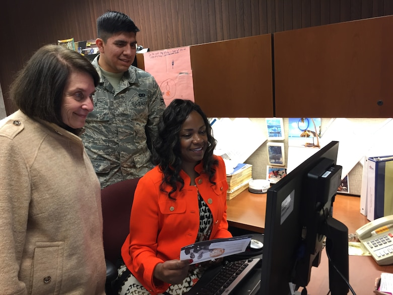 Susy Himelhoch (left), Ohio Combined Federal Campaign, Miami Valley District, volunteer executive director; Airman 1st Class JeremyTobar, CFC campaign loaned executive; and Chantaé Gray, loaned executive, review the new CFC pledge site Nov. 13. (Skywrighter photo/Amy Rollins)