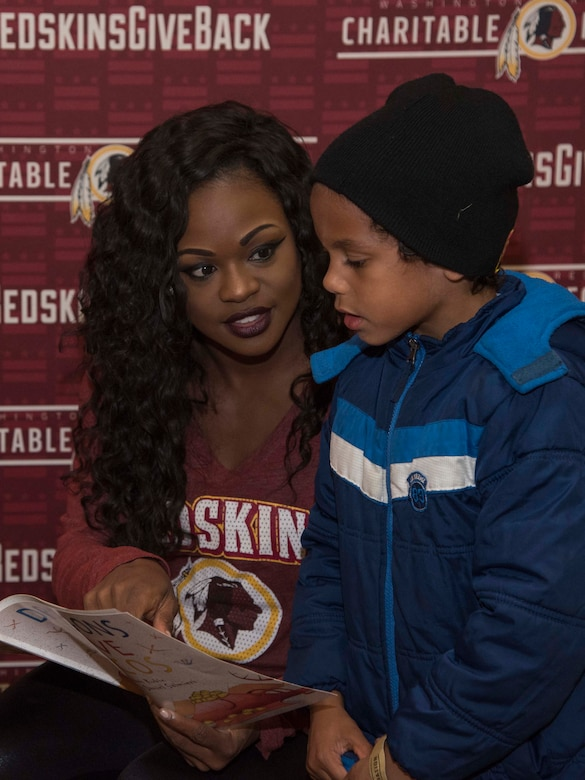 Cheerleader and child reading