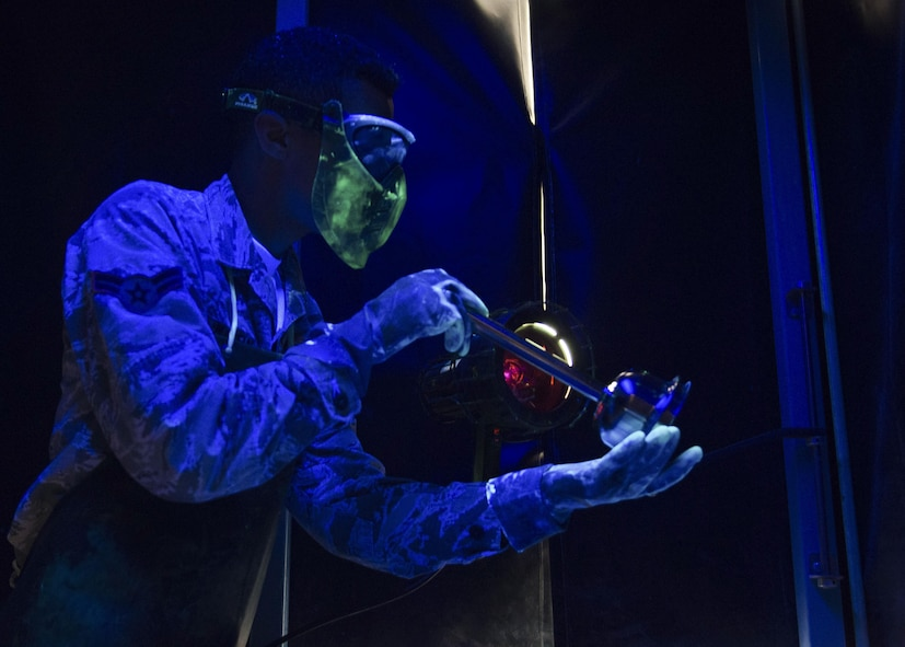 U.S. Air Force Airman 1st Class Dakota Martin, 1st Maintenance Squadron nondestructive inspection apprentice, inspects cracks under a black light at Joint Base Langley-Eustis, Va., Nov. 15, 2017.