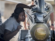A 20th Aircraft Maintenance Squadron Airman directs the loading of a bomb onto an F-16 Fighting Falcon Nov. 2 at Eglin Air Force Base, Fla.  A-10s, F-16s, F-22s and MQ-9s visited the base to participate in the 53rd Wing exercise. The 86th Fighter Weapons Squadron's Combat Hammer is a weapons system evaluation program for air-to-ground munitions. (U.S. Air Force photo/Samuel King Jr.)