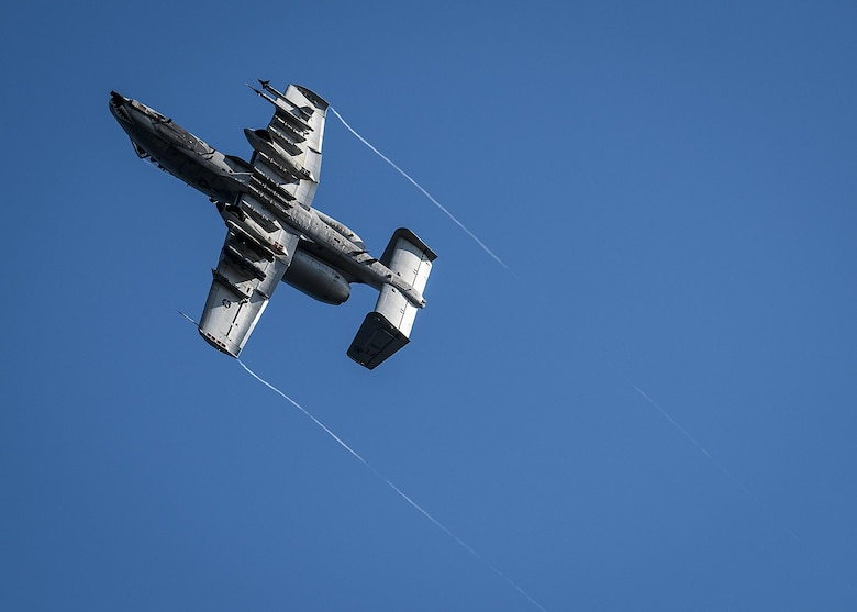 A 75th Fighter Squadron A-10 soars away after zooming in to target boats along Choctawatchee Bay during a Combat Hammer evaluation Nov. 3 at Eglin Air Force Base, Fla.  The boats swarm around the water creating a realistic environment to provide pilots an opportunity to train against maritime targets. The 86th Fighter Weapons Squadron's Combat Hammer is a weapons system evaluation program for air-to-ground munitions. (U.S. Air Force/Samuel King Jr.)