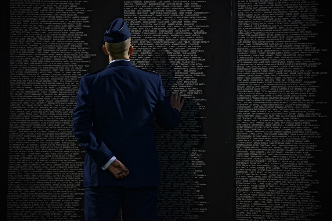 U.S. Air Force Capt. James Lanford, a 56th Fighter Wing chaplain, views and interacts with the American Veterans Traveling Tribute Wall in Buckeye, Ariz., Nov. 10, 2017. The wall is a replica of the Vietnam Veterans Memorial in Washington, D.C. and is engraved with the names of more than 58,000 service members reported killed or missing during the Vietnam War. (U.S. Air Force photo by Airman 1st Class Caleb Worpel)
