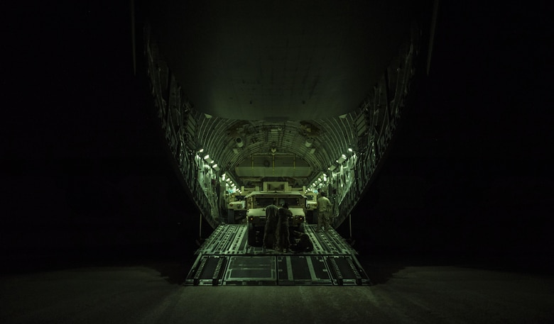 A U.S. Air Force C-17 Globemaster III aircrew from the 816th Expeditionary Airlift Squadron unloads high-mobility multipurpose vehicles during combat airlift operations at an undisclosed location, Nov. 11, 2017. The C-17 is capable of rapid strategic delivery of troops and cargo to bases throughout the U.S. Central Command area of responsibility. The aircraft can be outfitted to perform tactical airlift, airdrop, and aeromedical evacuation as missions require. (U.S. Air Force photo by Tech. Sgt. Gregory Brook)