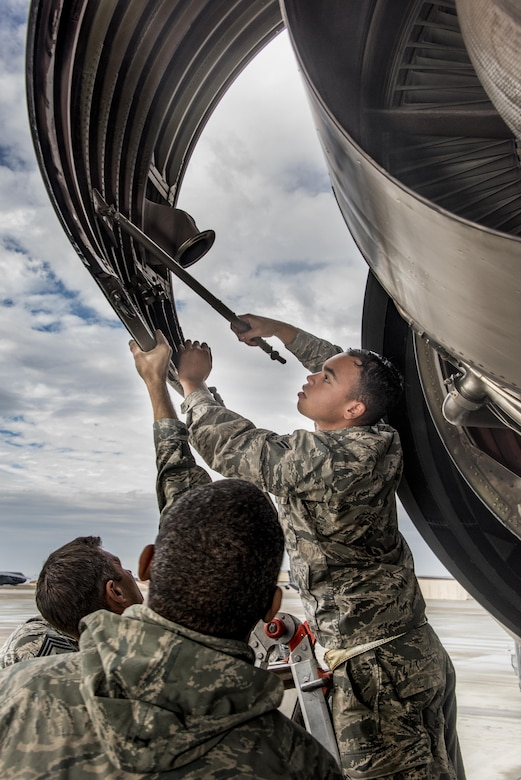 Airman 1st Class Juan Melendez, 660th Aircraft Maintenance Squadron, opens up a service panel to access a KC-10 Extender aircraft engine, Nov. 3, 2017, at Travis Air Force Base, Calif. The 660th AMXS is responsible for the safety and reliability of the fleet, thus strengthening American air power across the globe. (U.S. Air Force photo by Heide Couch)