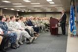 Defense Secretary Jim Mattis stands behind a podium at a town hall.