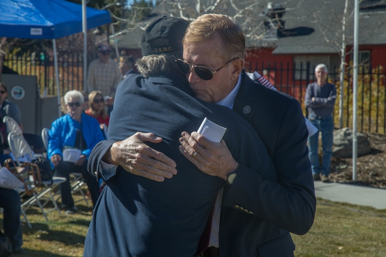 Congressman Paul Cook, Representative for California's 8th Congressional District and a  Marine Corps veteran, embrace prior to the Veterans Day ceremony at Big Bear Lake, Calif., Nov. 11, 2017. Cook was one of four distinguished guests who spoke at the event. (U.S. Marine Corps photo by Lance Cpl. Preston L. Morris)